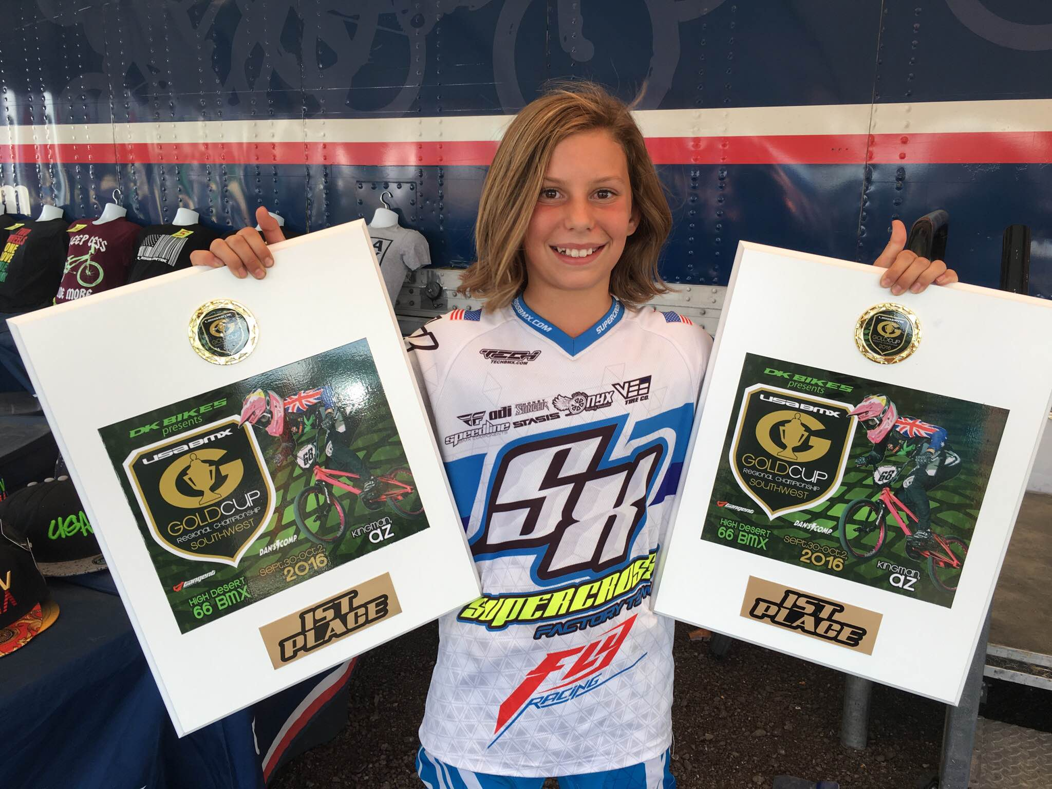 Bella Hammonds - Supercross BMX Factory Racer holding her USA BMX #1 Plaques