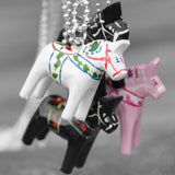Pink, white and black Dalecarlian (dalahäst) horse from Sweden.