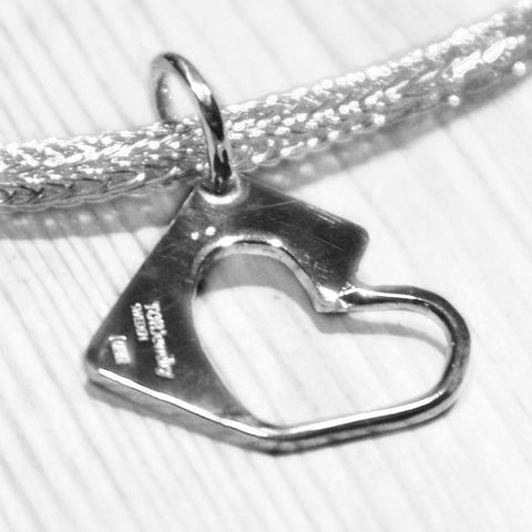 High quality sterling silver pendant formed as a heart.