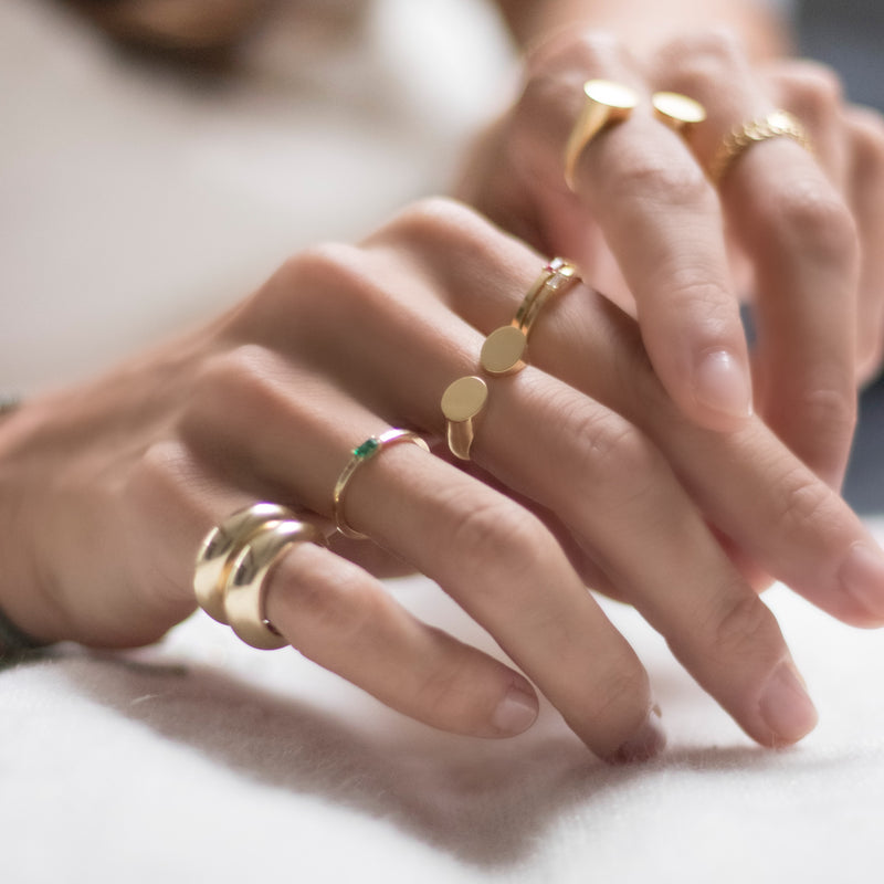 8 Karat Gold Rings with Emerald Baguette