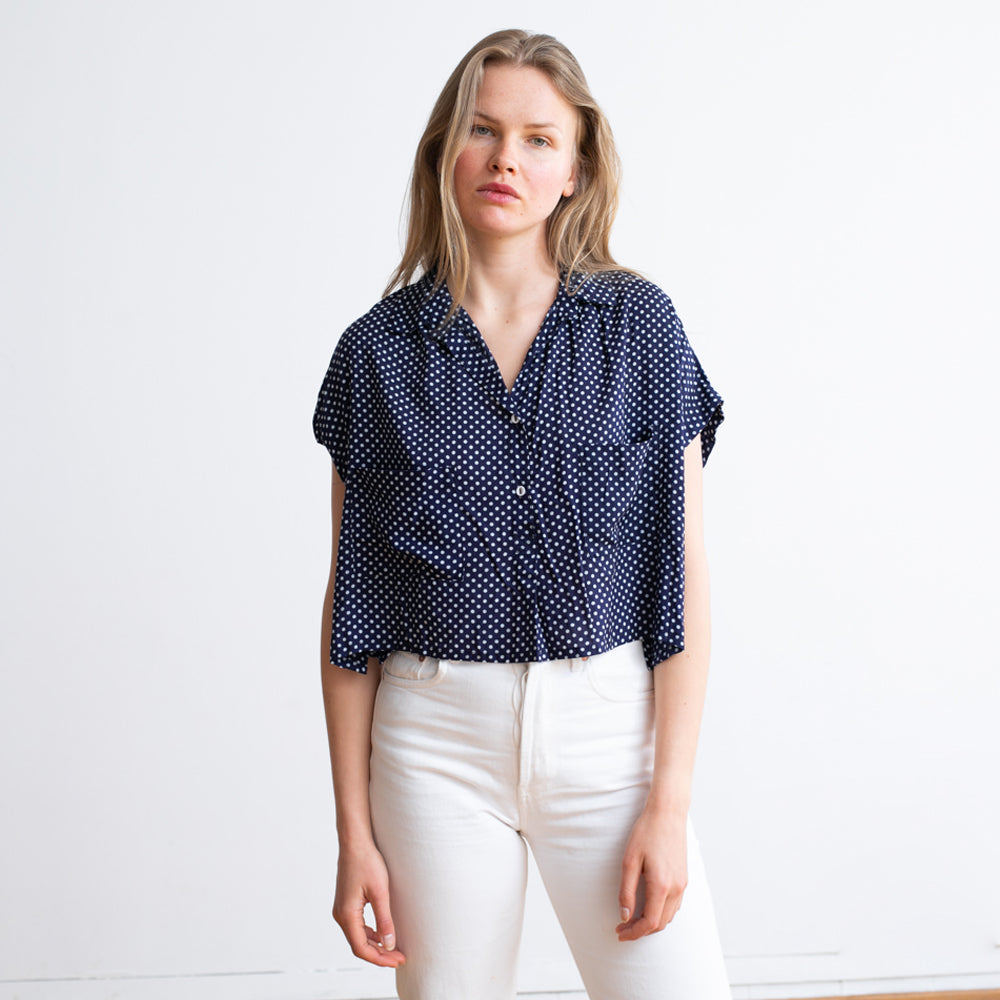 Polka Dots button down shirt.