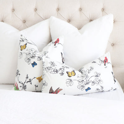 Schumacher Birds and Butterflies Multi on White Throw Pillow Cover on Bed