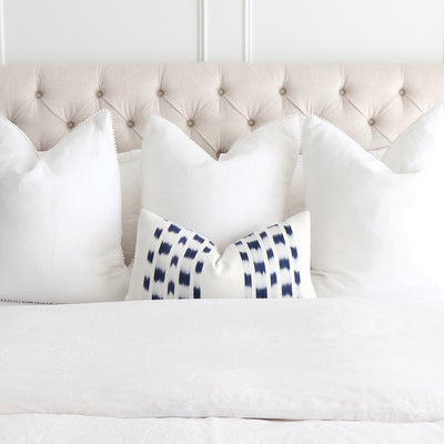 Schumacher Izmir Indigo Ikat Designer Throw Pillow Cover in Bedroom