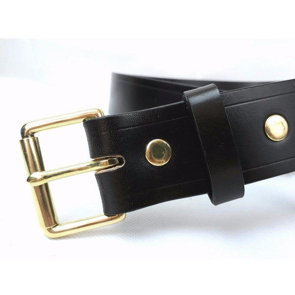 bridle leather belt with brass roller buckle close up