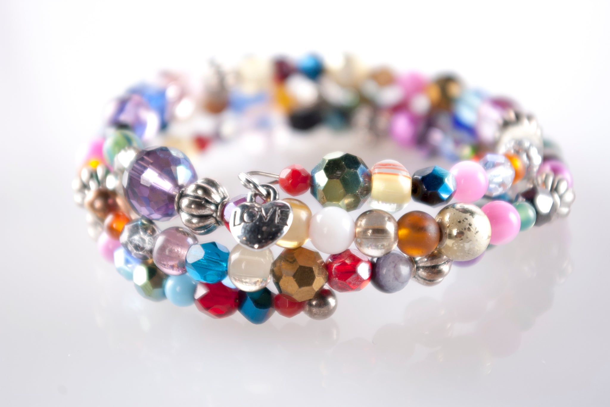Multi-colored glass and bead bracelet by love, p+c jewelry designs