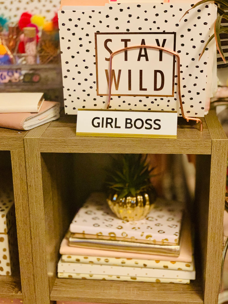 Image of desk plaque that reads girl boss