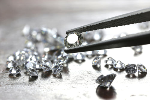 tweezer holding brilliant cut diamond