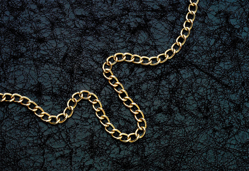 gold chain on black leather