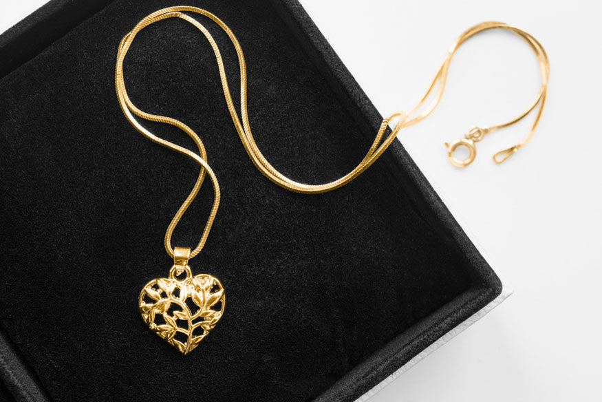 gold necklace carved heart