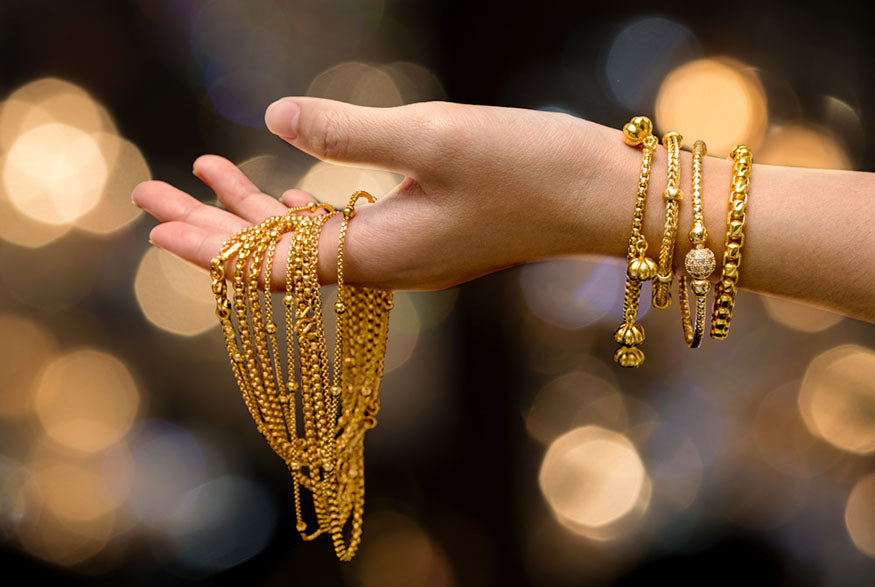 hand holding gold chains