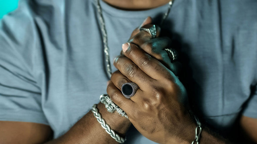 hands with mens rings and bracelets
