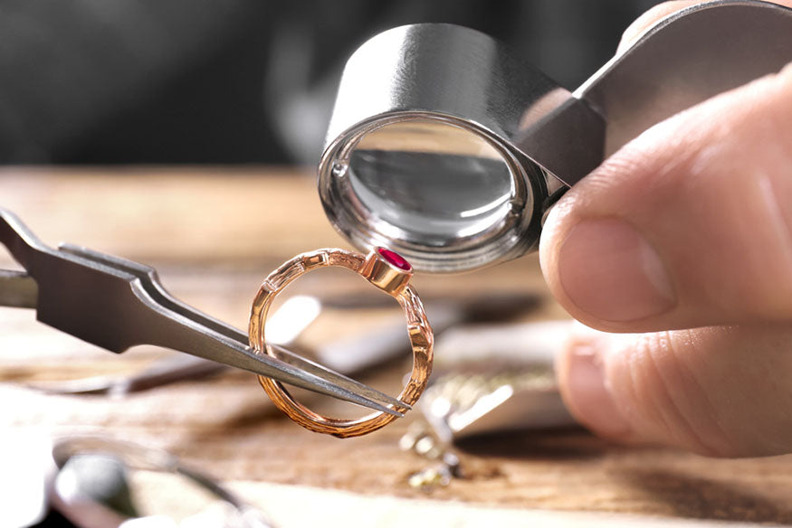 jeweler inspecting gold ring