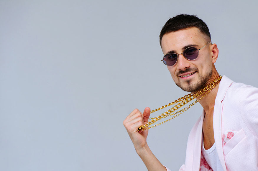 man holding gold chains