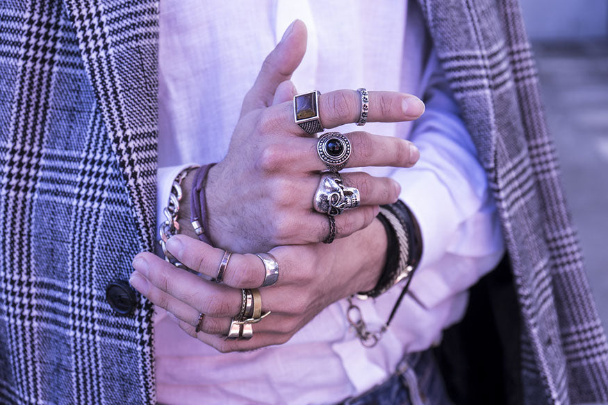 man wearing fashion rings
