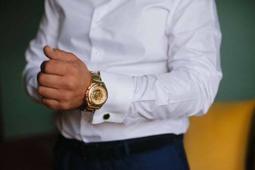 man with gold watch
