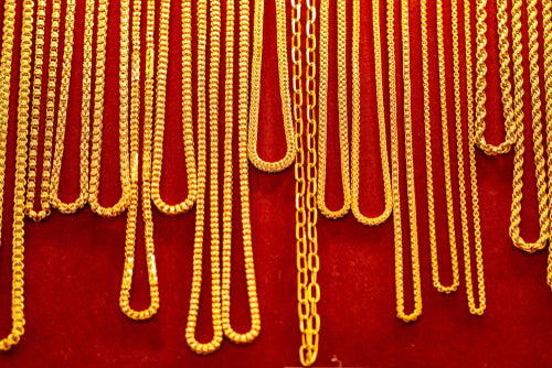 many gold necklaces