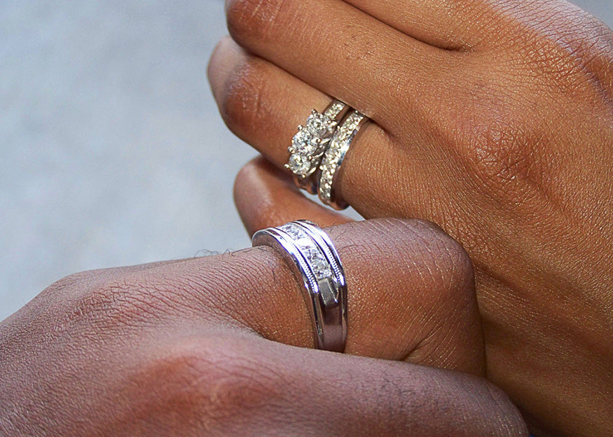 married couple showing off rings