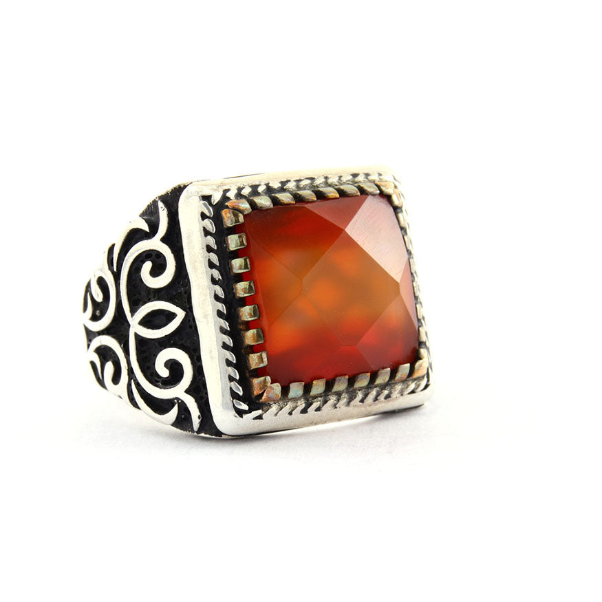 a mens silver ring inlaid with a large red stone
