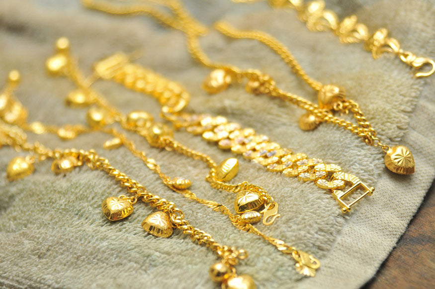 strands of gold necklaces drying