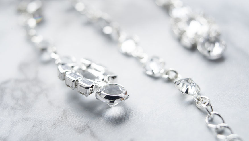 white gold chains with set diamonds