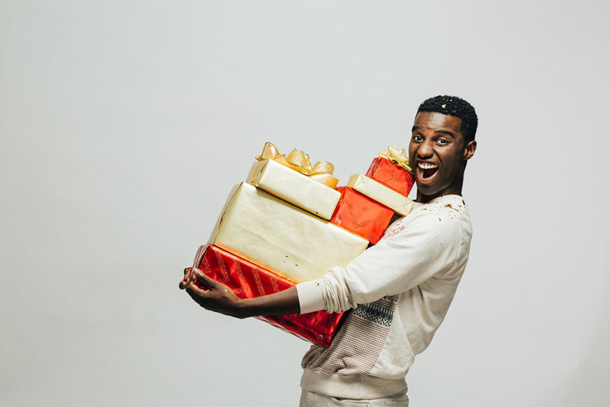 young man carrying many gifts