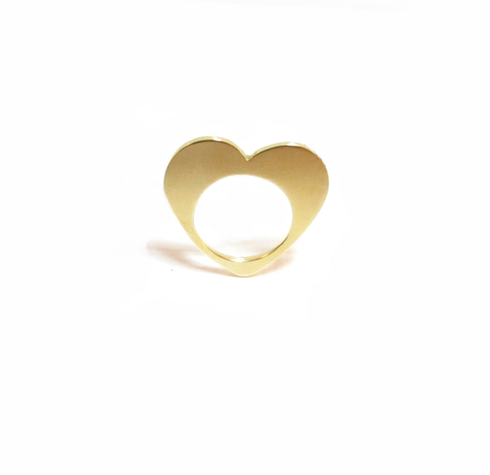 This image contains an 18 karat gold plated ring in the shape of a heart that can be worn as a pendant.