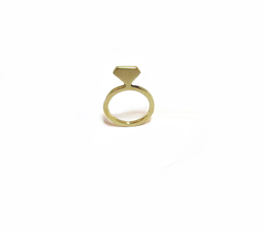 This image contains an 18 karat gold plated ring in the shape of a diamond ring silhouette that can be worn as a pendant.