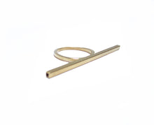 This image contains an 18 karat gold plated brass ring with a thin bar that goes accross 3 fingers