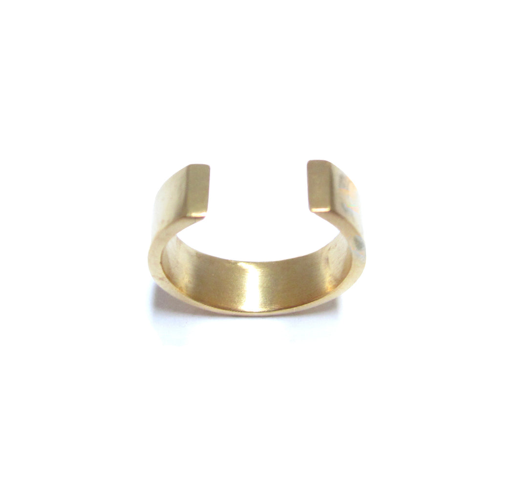 This image contains an 18 karat gold plated horseshoe ring.