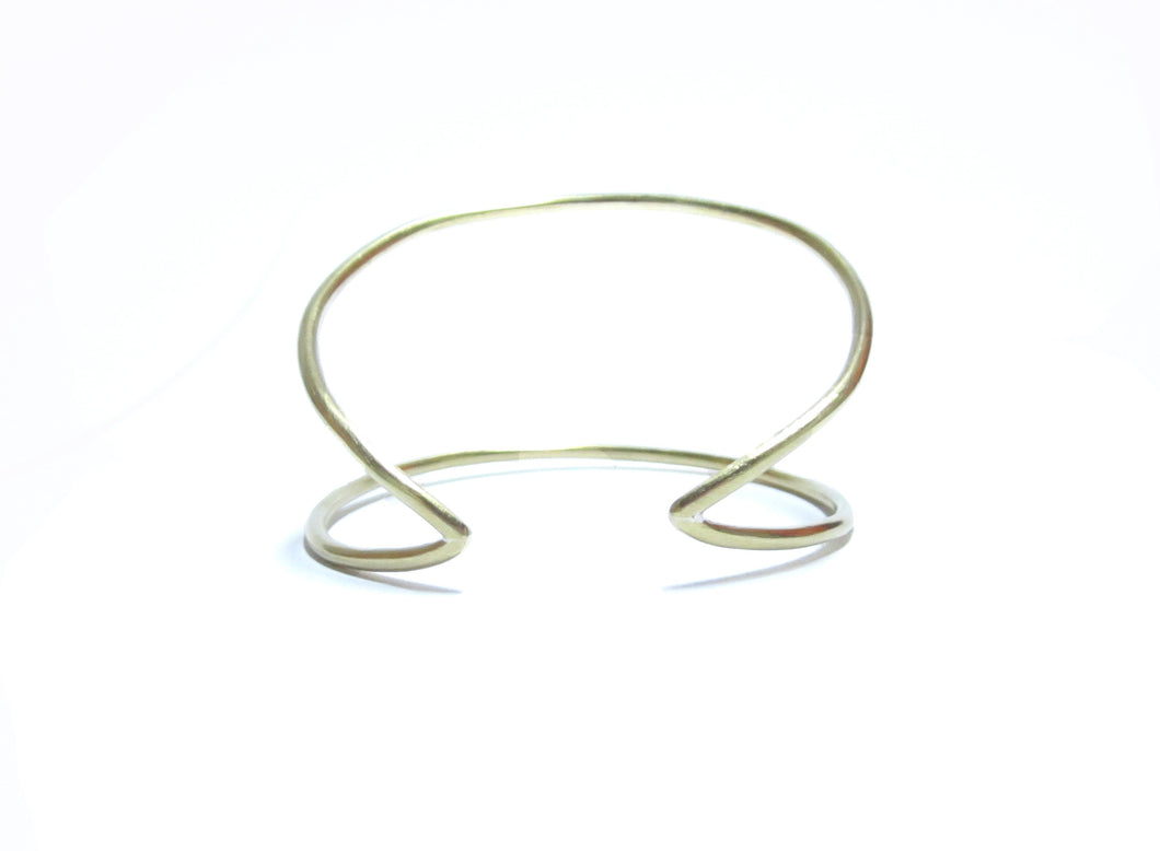 This image contains an 18 karat gold plated moon cuff.