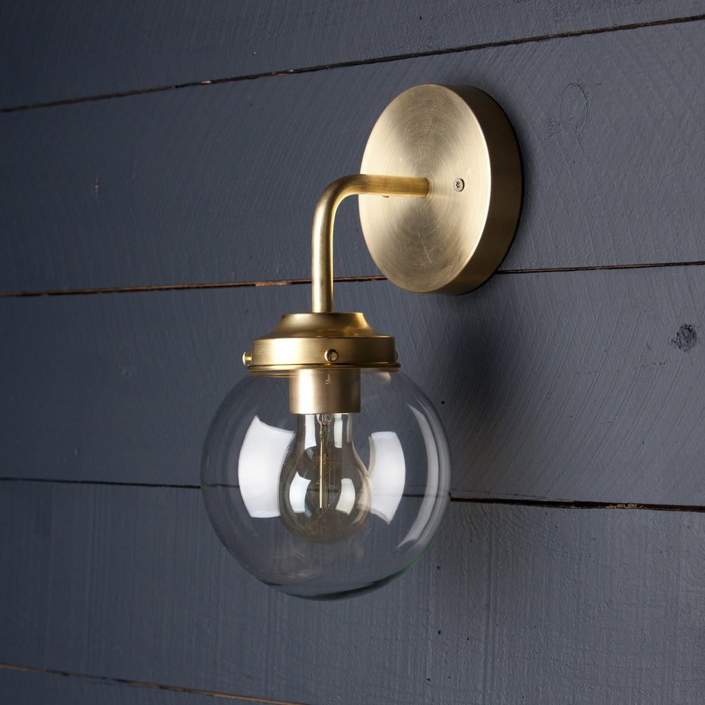 Clear Glass Globe Brass Wall Sconce