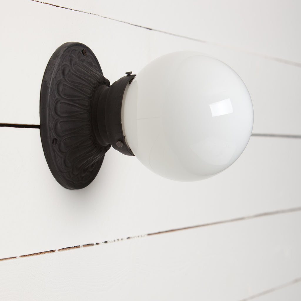 Milk Glass Globe Iron Sconce Light