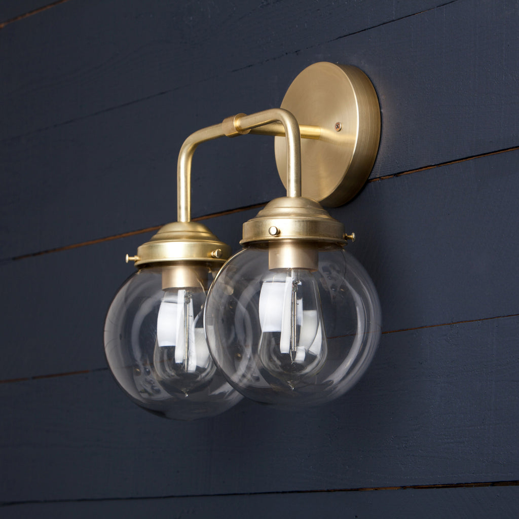 ... Double Clear Glass Globe Brass Wall Sconce ...