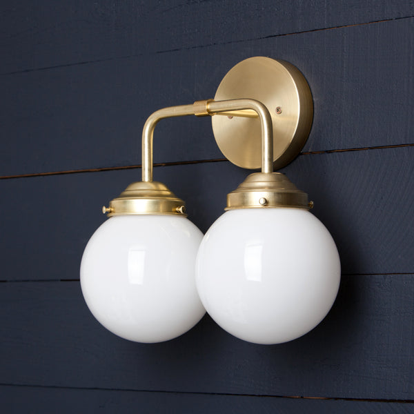 Double Milk Glass Globe Brass Wall Sconce
