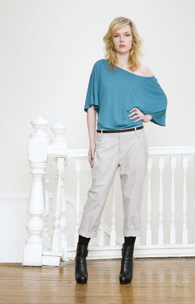 Pleated organic cotton pants front view.