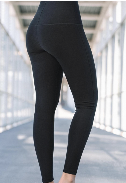 Back side view in black bamboo legging.