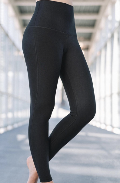 Side view of the black bamboo legging.