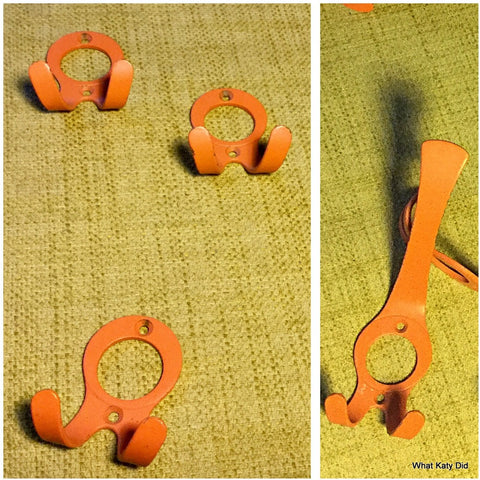 Fab 70s orange coat hooks Dutch retro