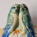 Kitsch budgies wall pocket