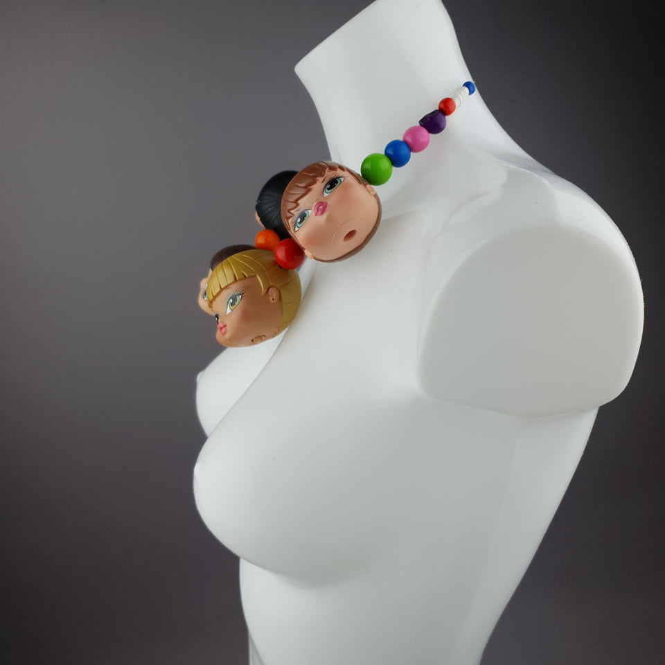 """Many Heads Are Better Than 1"" Colourful Doll Head Statement Necklace"