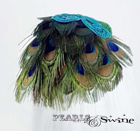 Sparkling peacock feather hat