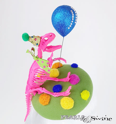 A Dinosaur with a balloon hat
