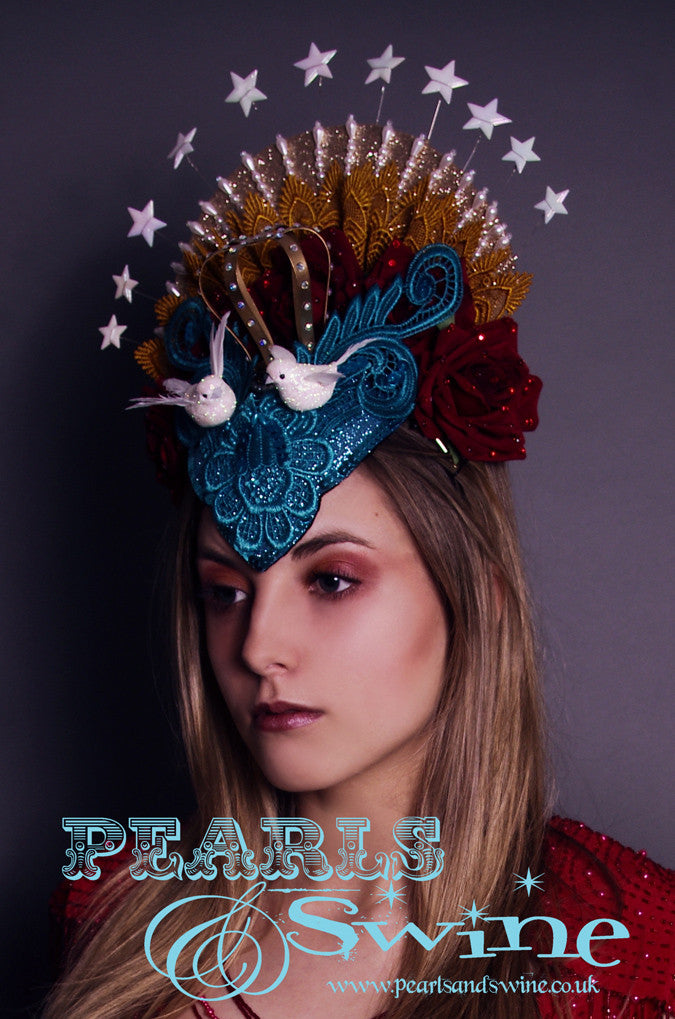 "Virgin Mary Headdress ""Queen of Angels""  The Virgin Mary headdress has turquoise glitter lace, roses, doves, stars, beading and a lush crown covered in crystals with a hand-moulded felt base set on a headband.   A piece of wearable art."