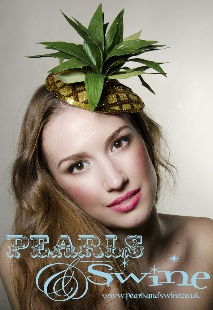 Fabulously kitsch pineapple fascinator decorated with sequins, gold glitter and leaves, backed with leopard print satin, this attaches with a comb and adjustable hat elastic.  Perfectly summery headpiece for lovers of retro fruit headpieces.