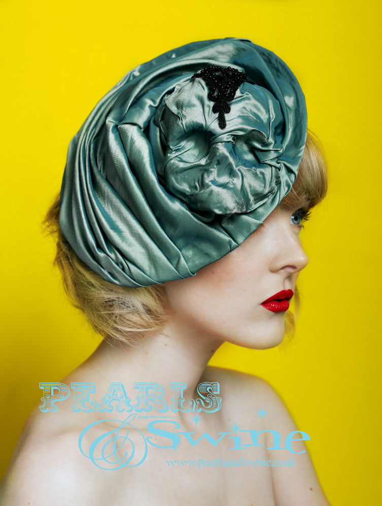 "One of a kind hat featuring a skull emerging from beneath an iridescent two toned green/teal taffeta fabric. This hat was inspired by the gorgeous TV series ""Penny Dreadful"", i don't know how or even why but that is how it works sometimes. This hat attaches with a comb and adjustable hat elastic, it's backed with taffeta. Perfect for lovers of Victorian fashion or goth fashion."