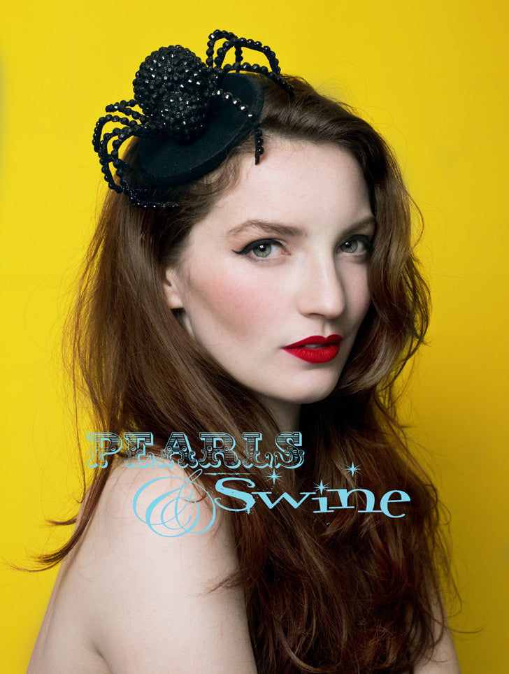 "Spider Fascinator ""The Glamorous Spider""   A large black glittered and hand-jewelled spider, set on a felt fascinator base which is edged in black velvet ribbon. Attaches with a comb and adjustable hat elastic. Perfect headpiece for Halloween, goth fashion and spider lovers."