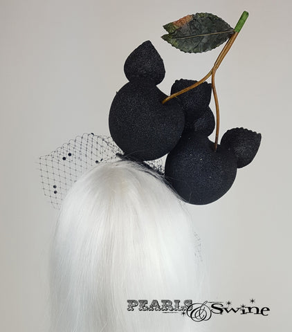 back of Black glitter giant cherry cats with a veil