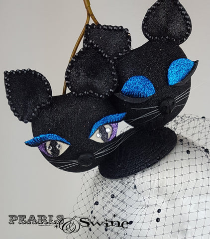 Black glitter giant cherry cats fascinator with a veil