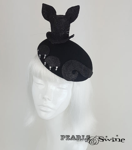 Black glitter mini top hat with cat ears and whiskers set on a blocked felt hat decorated with cat paws and crystal claws.