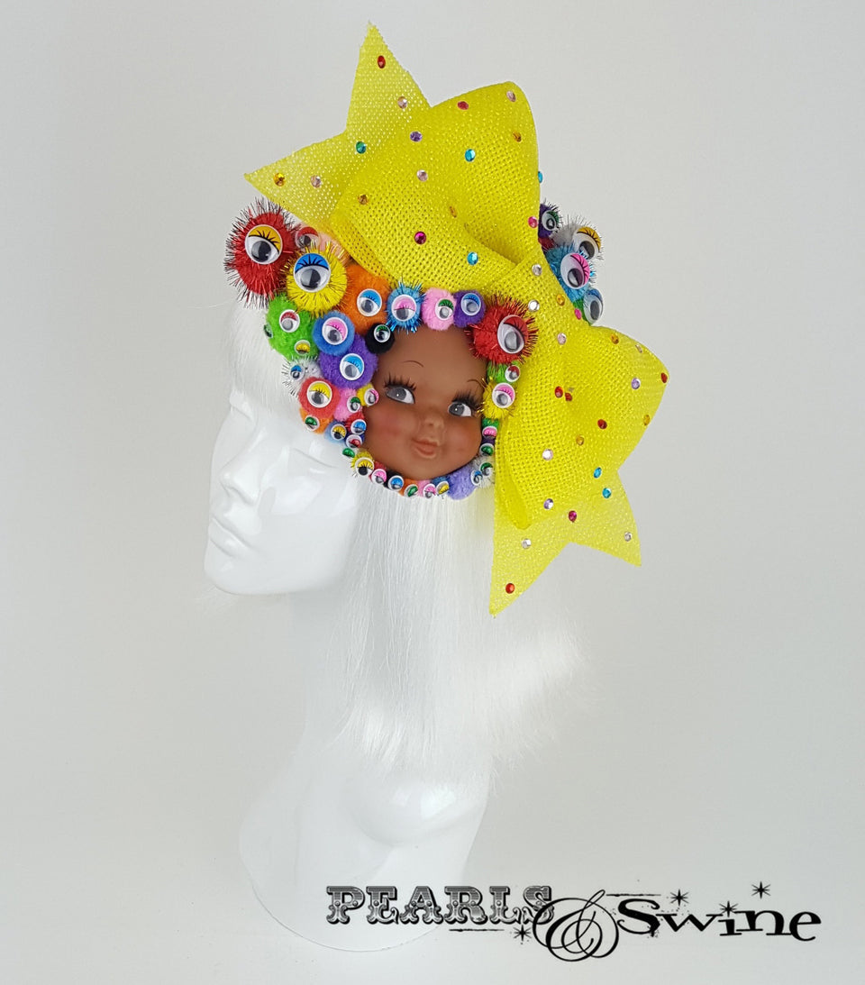 bow pom pom wiggly eye doll face fascinator